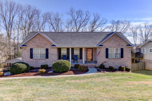 Immaculate Brick Front Basement Ranch with oversized garage, two car carport, and large fenced yard
