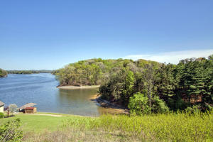 Incredible Lake View, Over 1 Acre, Dockable in a Beautiful Private Neighborhood with Mature Trees
