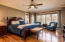 Main level master suite with serene wooded views