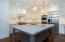 6 cm ogee marble countertop. Plenty of casual seating around the large island.