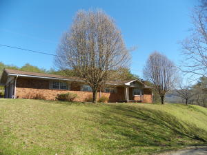 All Brick Rancher sitting on almost 3 Acres of land with scenic views of mountains