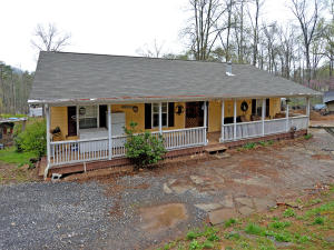 MINI-FARM ON 2.5 ACRES! Nestled on over two unrestricted acres, this cozy one-level home has immense potential and is an ideal location for horses! Highlights include a large detached garage/workshop, two pastures, 1.5 fenced acres, and an arena to work with your horses! The lofted barn includes 4 10 x 10 stalls, a wash bay, utilities, and extra storage. Enjoy a peaceful evening from the relaxing covered front porch!  Easy commute to downtown Knoxville, Sevierville, Maryville, and Pigeon Forge! Less than an hour from the Smoky Mountain National Park!