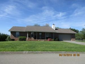 All brick ,one level ranch home that is handicap accessible .Has ramp in garage and step in shower and wide doors. Screened back porch to view mountains . Large covered front porch . Flat yard, easy access to Seymour or Sevierville in the heart of Boyds Creek .Three bedrooms and two full baths,wood burning fireplace in living room,plenty of counter space and island in kitchen. All appliances stay . Double garage and nice sized utility room . Low utilities and taxes. Make an appointment to see today