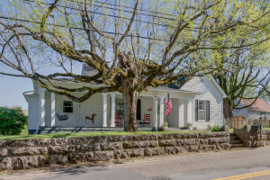 Welcome Home to 2817 Asbury Rd. This porch, stone wall and tree is EVERYTHING!