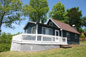 LAKE HOME!!! STUNNING VIEWS ALL AROUND!!! This cozy lakefront home offers great views and direct access to the lake. One bedroom with loft!!! Plenty of deck to sit and enjoy the beautiful lake views!!! Detached Garage /Workshop!. PROPERTY COMES WITH ITS OWN BOAT DOCK! Own a piece of Paradise! For more information call us today!!!