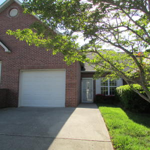 Brick Front and Vinyl with one car garage