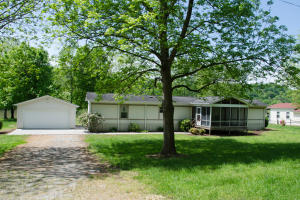 Own your own river side retreat. Sitting on a 1.23 acres level lot this 1 bedroom, 2 bonus rooms, 2 bath mobile home has a permanent shingled roof added. There also a screened in front and back deck for outside enjoyment Also there is a site built one car garage. With 200 ft of French Broad River front there plenty of room to add a dock. The property is equipment with a well and the home is hooked up to utility water. The huge level back yard can accommodate a plethora of outdoor activities. Just in time for the Summer!