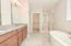 w/tile floors, granite counters, tiled shower and free standing tub
