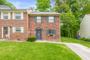 Brick front Townhome with off street parking