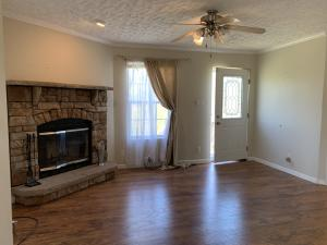 Adorable 2 bedroom 2 bath private oasis that's close to EVERYTHING!! Open floor plan with large kitchen island, stone stacked fireplace and dining/office/bonus room with glass french doors. Home sists on 3.23 unrestricted acres, nice front deck, BBQ area and storage shed.