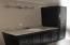 Master bathroom w/new cabinets, granite countertop, light fixtures, and mirror