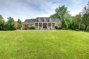 Welcome home to this lovely custom built home nested on 7 plus acres