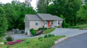 LOCATION! Convenience! Easy commute to Pigeon Forge, Sevierville & Gatlinburg! Quiet neighborhood.  Backyard borders woods & is fenced. Over sized rear deck. Home has been WELL maintained. Cathedral ceiling in kitchen & LR. All appliances remain. Split bedroom plan. Walk in closets. Additional storage in basement. 2 car garage in basement.  Nicely landscaped. Come take a look today!