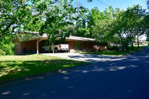 A perfect place to call HOME . 3BR, 2 BA , W/B fireplace,minutes to downtown, yet away from heavy traffic. A large corner lot in  an established neighborhood with beautiful trees and plenty of space . A nice huge deck off the back to enjoy your privacy and entertaining. New Roof and HVAC in the spring of 2018.