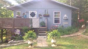 If you are looking for a little peace and quiet near the Great Smoky Mountains, then you have found your place. This well-maintained 2 bedroom/1.5 bath home sits on 1 acre, and is convenient to Sevierville, Pigeon Forge, and Gatlinburg. The wrap around porch is just the spot to enjoy your cup of coffee in the morning or evening sunsets, as well as seasonal mountain views. Make this your permanent residence or an investment property/overnight rental. This home is priced to sell.  Although the home is being sold ''as is'', the current owner knows of no problems.