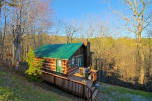 INVESTORS! Great opportunity to own an income producing 1 bedroom/2 bath cabin, in a desirable location, only minutes to attractions. Nestled in a wooded setting. Property is being sold fully furnished. Interior features include: Master Suite with jet tub, a stone wood burning fireplace in the living room and a fully equipped kitchen, covered back deck with hot tub perfect for relaxing, and a foosball table. Easily accessible location, NO STEEP ROADS! This will go quick! Property being sold AS IS