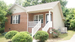 HARD TO FIND IN SEVIERVILLE! 3BR/2BA HOME IN DESIRABLE LOCATION ONLY MINUTES TO SCHOOLS, SHOPPING, RESTAURANTS, DOLLYWOOD, ETC. This is a great starter home, investment property, etc.! Interior features include spacious floorplan with open kitchen with appliances, plenty of cabinets and counter space, and also a huge snack bar! Oversized Master Suite with walk- in closet, an extra closet, and private bathroom. Second and third bedroom are very spacious with plenty of closet space. Laundry area with washer and dryer. Covered front porch for rocking. Nicely manicured lawn. Easy access location. This is a must see!