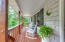 Front porch overlooks private wooded acreage