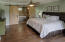 Master Bedroom easily accommodates a king bed & check out those barn doors!