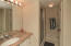 Full bath on lower level between 4th Bedroom and Den