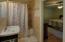 Master Bath including tile and a spacious linen closet