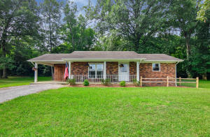 Adorable brick ranch home located only minutes from downtown Sevierville. This home features 2 BR/1 BA and a large living room with beautiful double window with lots of natural light. Off of the hall you will find the large eat in kitchen/dining area leading to the laundry room and access to the carport. The property also features a large flat lot with plenty of space for entertaining, a children's play set or garden, as well as a fenced in area on the back of the home for pets. The home is conveniently located to Downtown Sevierville, Veterans Blvd, Tanger Outlets, Dollywood and many other attractions!