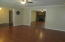 Living/dining view into family room and foyer