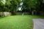 Large level fenced rear lawn