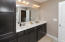 Great storage, double sinks and a tub/shower unit serves the bedrooms