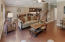 Hardwood flooring unifies the open plan