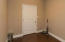 Mudroom/flex space offers a buffer between garage and living space. Great drop zone potential or a cozy office