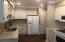 Granite countertops, new can lights, new bronze fixtures & pantry!