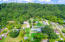 Another view of this expansive home with mature trees and tons of yard for kid and pet play!