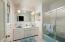 Relaxing 8x8 master bath with dual sink vanity & glass door tub/shower!
