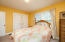 This spacious bedroom includes two large closets and full bath next door!