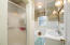 Main level guest bath measuring 9x7 with stand-up shower plus separate tub!
