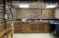 Everything here is negotiable with purchase. The custom built work bench and storage areas are a dream for any handy man!