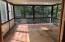Four seasons room with hardwood flooring.
