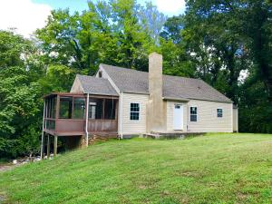 Adorable Cape Cod with new roof and new vinyl siding, fully restored chimney located on a charming, wooded street in an established neighborhood.
