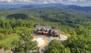 What a setting! What a backyard view! Enjoy the Great Smoky Mountains all the time from this luxury mountain home.