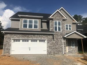 Craftsman Style with beautiful Stone, Board & Batten and Shake front exterior.