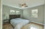 Spacious Master Bedroom with hardwood floors and ceiling fan