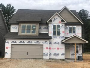 Craftsman Style with beautiful Stone and Shake front exterior.