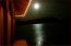 A full moon reflects off the water.