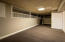 Awesome Basement Storage Room with Ledge Bays for Kid Play or Hobbies