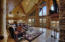 Cathedral ceiling, mountain views, open floor plan design.
