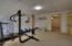 Currently used as an exercise room this is a large bedroom with an ensuite bath and an adjacent room open to your imagination, plus there is a large walk-in-closet!