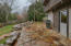 Stone Pavers and Storage Shed in Fenced Backyard