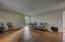 Spacious living room with hardwood flooring