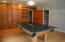 Large Family room with built in shelving and storage (main level)